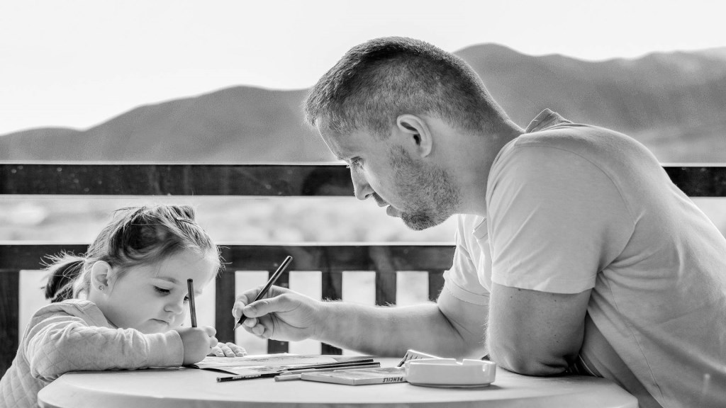 father and daughter on fathers day coloring together